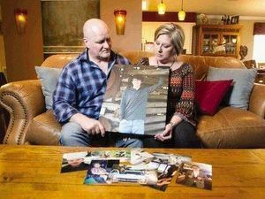 Tyler and Traci Hobson look at a portrait of their son, Grant, who died Feb. 7 after ingesting synthetic LSD. Ever since, they have tried to raise awareness of the drug's dangers.