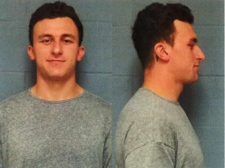 Johnny Manziel has been booked and posted bond in a domestic violence case, one day before the former Cleveland Browns quarterback faces his first court hearing.