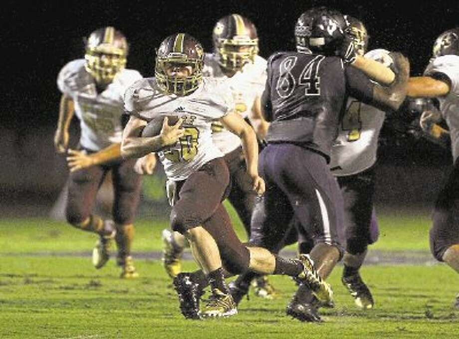 Magnolia West running back Chris Nicholson runs for a touchdown against Willis on Friday at Berton A. Yates Stadium. To view or purchase this photo and others like it, visit HCNpics.com. Photo: Staff Photo By Jason Fochtman / @WireImgId=2643232