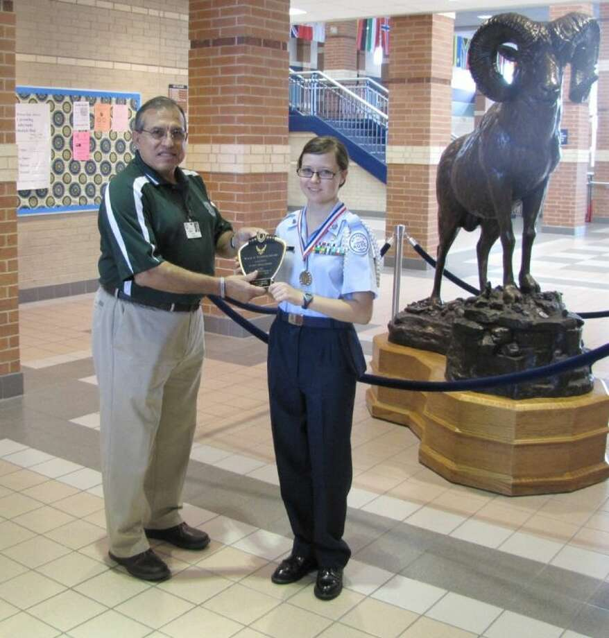 Cypress Ridge High School AFJROTC Cadet Anna Good, sophomore, was named the No. 1 overall graduate of the Prairie View A&M Summer Leadership Program in June, earning the Willie A. Tempton Award. Pictured with Good is Cypress Ridge principal Claudio Garcia. Photo: Submitted Photo