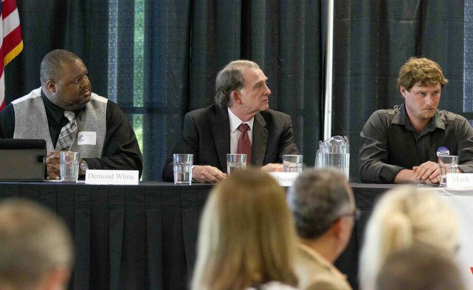 Candidates for Conroe City Council position 2 including Demetrius White, Seth Gibson and Mark Frank are seen during a political forum at Lone Star Convention & Expo Center on Thursday in Conroe. Photo: Jason Fochtman