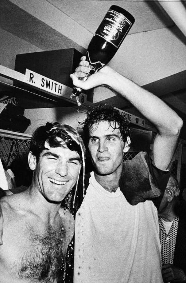 In this Sept. 25, 1978 file photo, Los Angeles Dodgers pitcher Bob Welch, right, wets down first baseman Steve Garvey with champagne in Los Angeles after the Dodgers clinched the National League Western Division title.