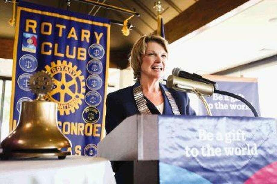 Doris Lockey gives her acceptance speech after being installed as district governor of Rotary District 5910 Saturday at the Walden Yacht Club. Photo: Michael Minasi