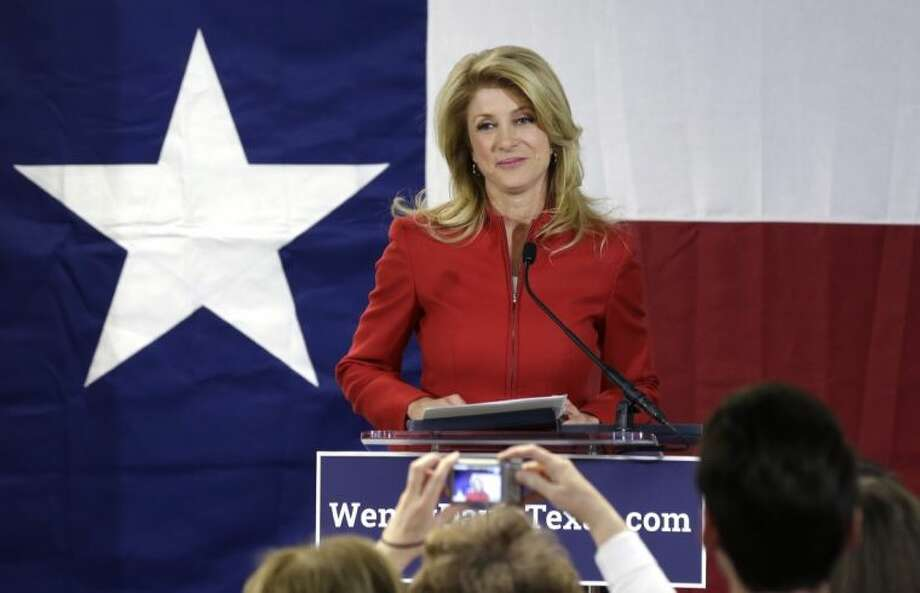 In this March 4 file photo, Texas Sen. Wendy Davis, D-Fort Worth, pauses as she speaks to supporters at her campaign headquarters, in Fort Worth. Davis announced Wednesday that Karin Johanson, who has managed Davis' underdog bid for Texas governor, has left the campaign and will be replaced by Arlington state Rep. Chris Turner.