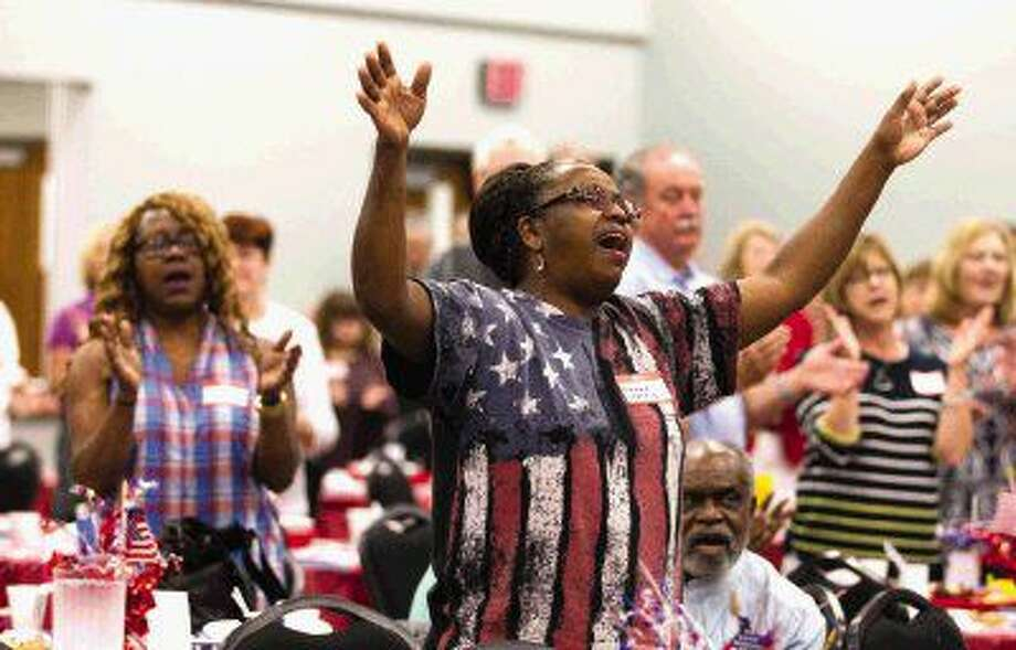 Renae Harris worships as the Martin Luther King Jr. Community Choir performs during a National Day of Prayer breakfast Thursday in Montgomery. Go to HCNpics.com to purchase this photo and others like it. Photo: Jason Fochtman