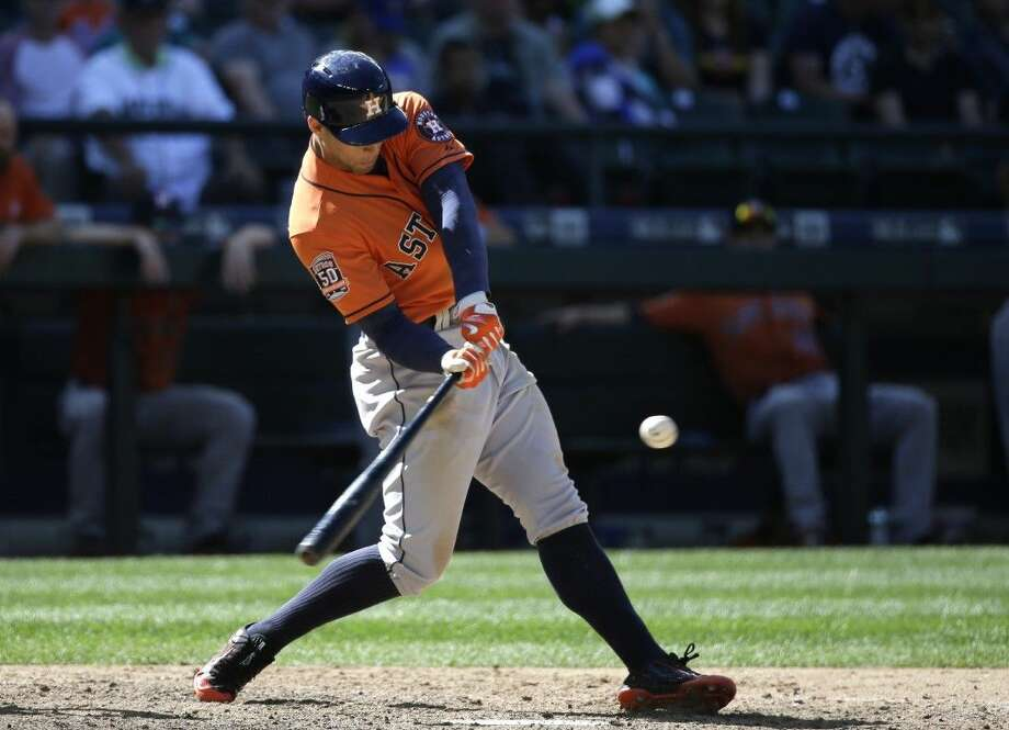 The Astros' George Springer puts the ball in play in the team's 6-2 victory over the Seattle Mariners. He had a home run in the game. Photo: Elaine Thompson