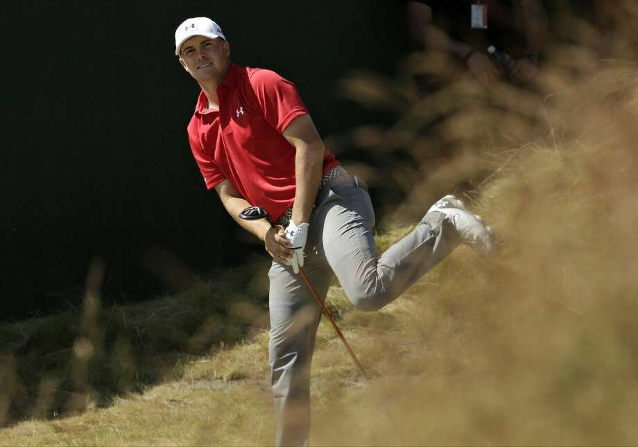 Jordan Spieth watches his tee shot on the seventh hole at Chambers Bay on Saturday in University Place, Wash. Photo: Charlie Riedel