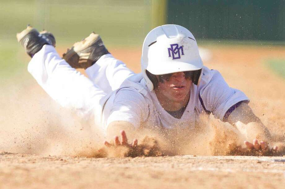 Montgomery's Brandon Shearer slides into home to score off an 2 RBI single by Tyler Wernli during the fifth inning of a Region II-6A bi-district playoff game Friday in Montgomery. Go to HCNpics.com to purchase this photos and others like it. Photo: Jason Fochtman