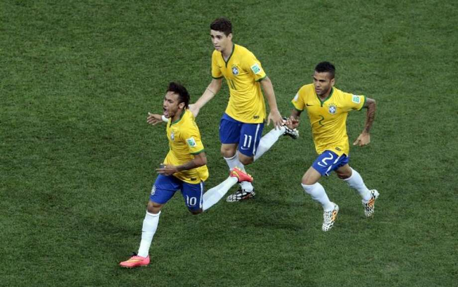 Brazil's Neymar, left, celebrates scoring his side's first goal during a Group A match against Croatia in the World Cup opener on Thursday at Itaquerao Stadium in Sao Paulo. Photo: Shuji Kajiyama