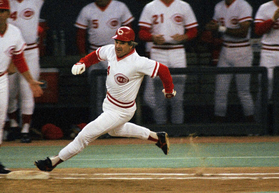 FILE - In this Sept. 11, 1985, file photo, Cincinnati Reds' Pete Rose rounds first base after hitting a single to break Ty Cobbs' hitting record during a baseball game at Riverfront Stadium in Cincinnati. . ESPN says it obtained a notebook that shows Rose bet on Reds games during his last season as an active player in 1986. The career hits leader agreed to a lifetime ban from baseball in 1989 after an investigation by John Dowd, a lawyer retained by Major League Baseball, concluded he bet on the Reds to win from 1985-87, during his time as a player and manager. (AP Photo/File) Photo: Anonymous