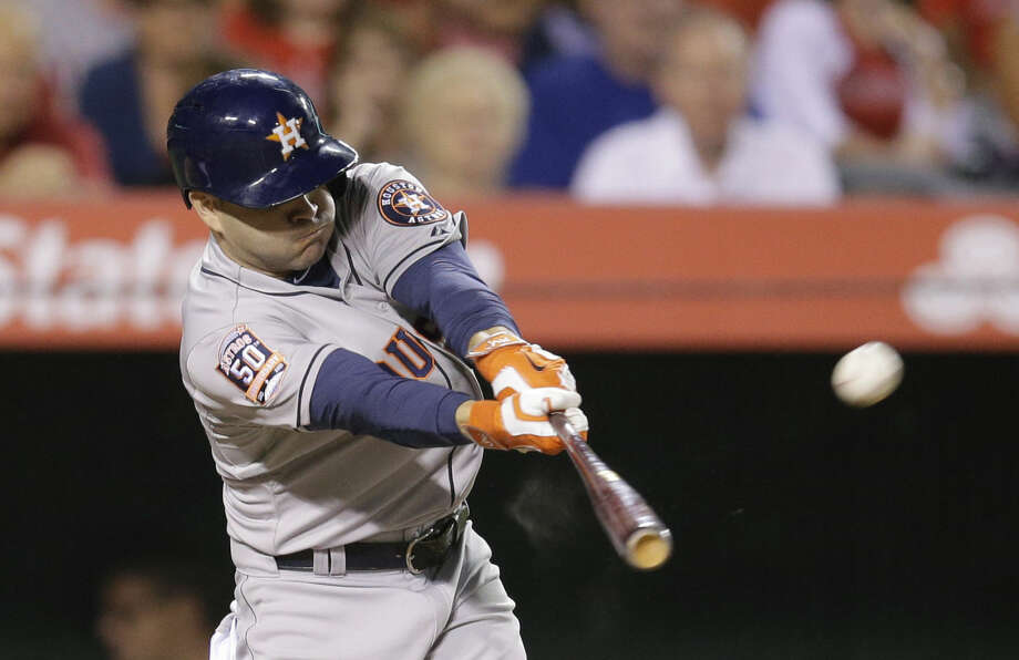 Houston Astros' Jose Altuve hits an RBI ground rule double to tie the game during the eighth inning of a baseball game against the Los Angeles Angels, Monday, June 22, 2015, in Anaheim, Calif. (AP Photo/Jae C. Hong) Photo: Jae C. Hong