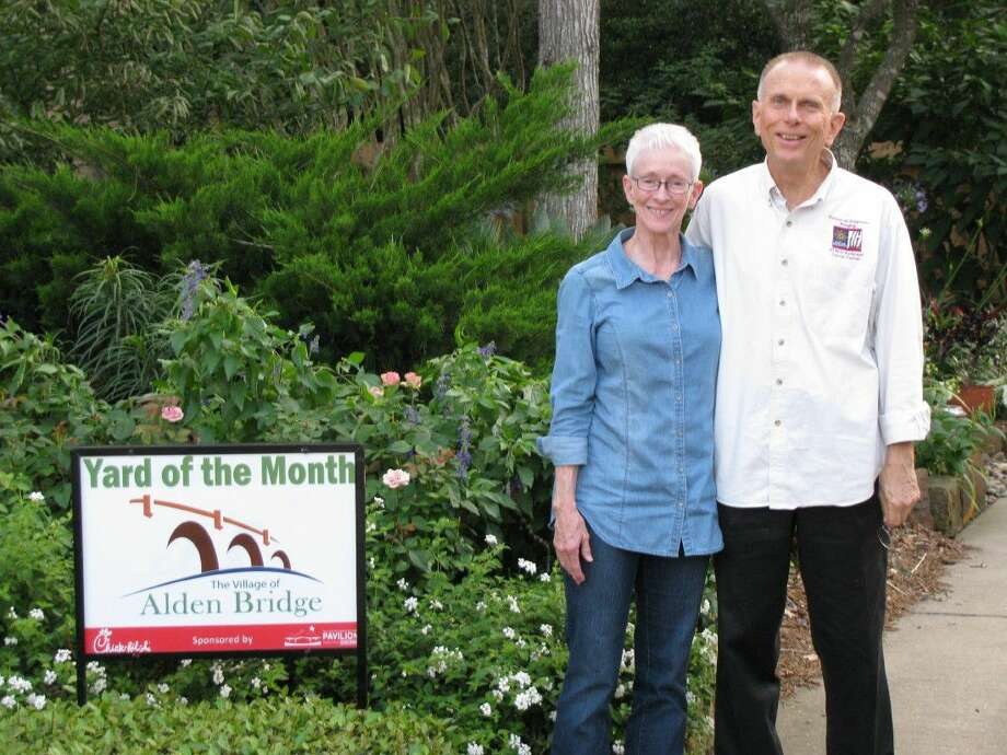 Gayle Storey and Tony Benedetto of Timberlea Place in Eagle Mead in the Alden Bridge Village had their yard named Yard of the Month for May.