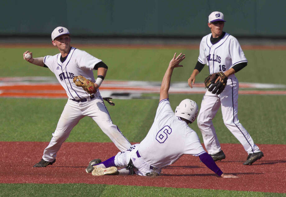 Willis shortstop Christian Cornelius turns a double play as Matthew Bennet slides in to second during the first inning of a District 18-5A game Saturday at Sam Houston State University in Huntsville. Go to HCNpics.com to purchase this photo and others like it. Photo: Jason Fochtman