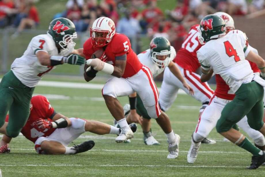Katy sophomore Kyle Porter scored three touchdowns in the Tigers' weather-shortened 42-0 rout of Mayde Creek Sept. 20 at Rhodes Stadium. The game was called at halftime. It was the District 19-5A opener for both teams. Photo: Alan Warren