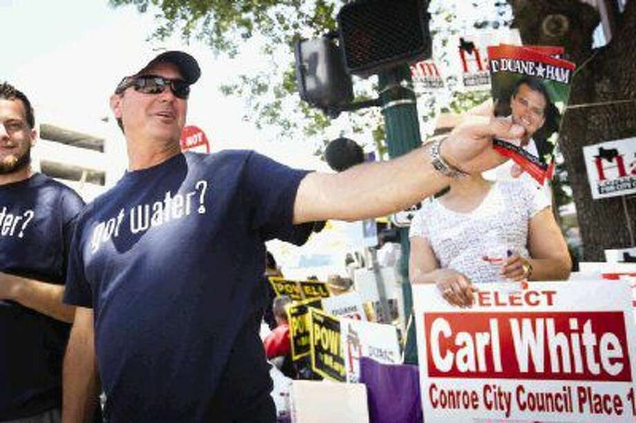 Duane Ham, candidate for Conroe City Council Place 1, campaigns on Saturday in downtown Conroe. Photo: Michael Minasi