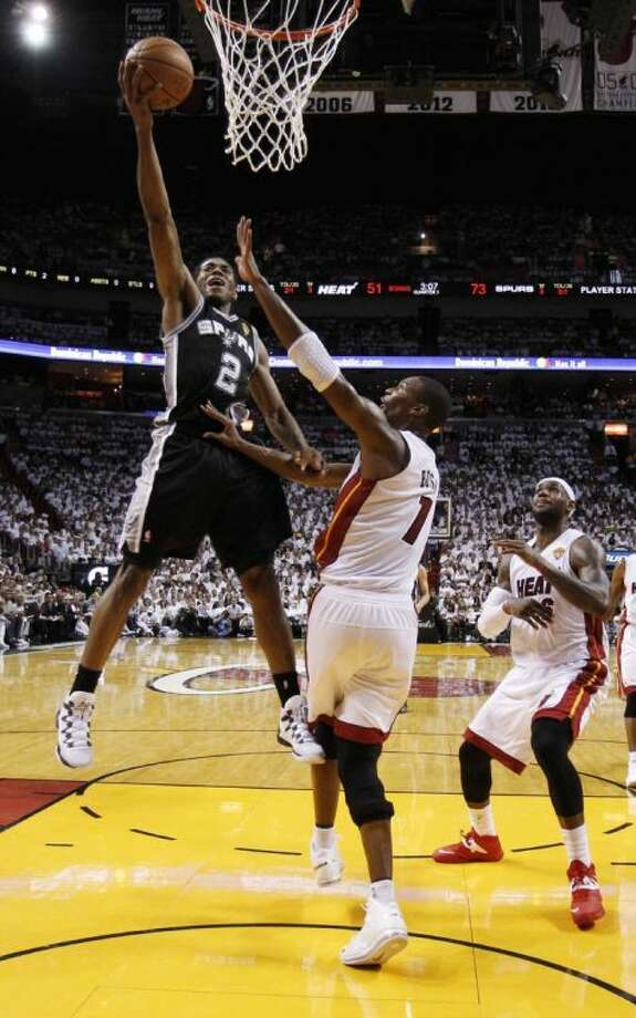 Kawhi Leonard, left, and the Spurs take a 3-1 NBA Finals lead into Sunday night's home game against the Miami Heat. Photo: Wilfredo Lee