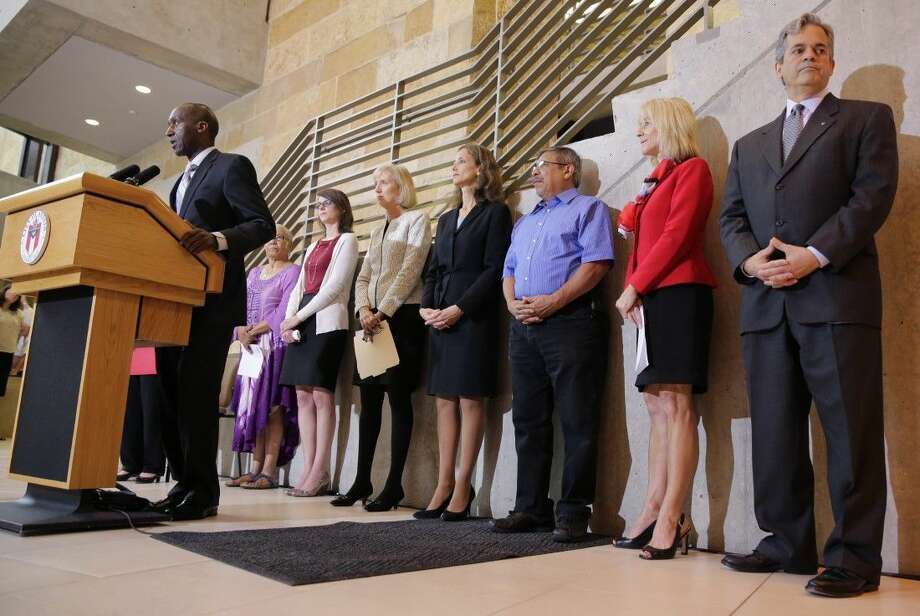 Members of the Austin city council listen to city manager Marc Ott during a news conference at City Hall, Wednesday in Austin. Photo: Eric Gay