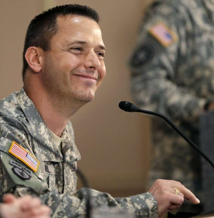 Col. Ronald Wool smiles after answering a question about Sgt. Bowe Bergdahl's food requests, during a news conference Friday in San Antonio.