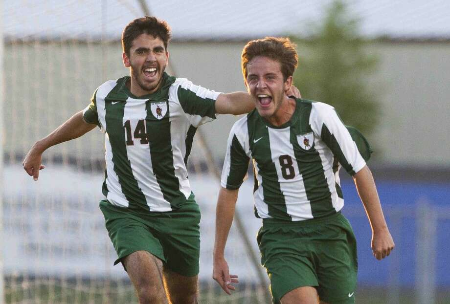 The Woodlands midfielder Julen Ormaza celebrates along with forward Rafael Ortiz after scoring a goal off a corner kick by Nicholas Pekel during the first period a Region II-6A regional quarterfinal match at Klein Memorial Stadium Tuesday. Go to HCNpics.com to purchase this photo and others like it. Photo: Jason Fochtman