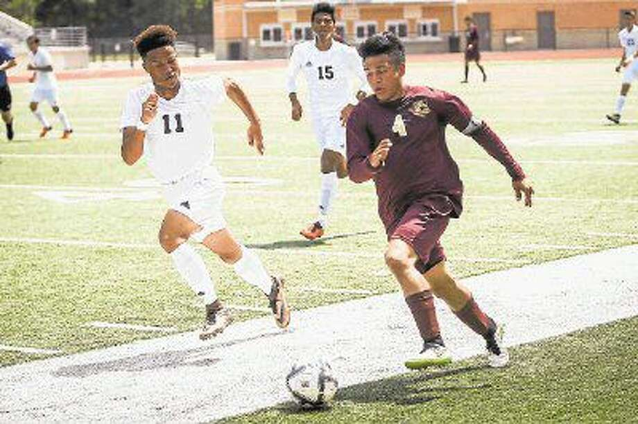 Magnolia West's Bryan Zavala (4) moves the ball during the high school boys soccer game against Goose Creek Memorial on Friday at Turner Stadium. To view more photos from the game, go to HCNPics.com. Photo: Michael Minasi