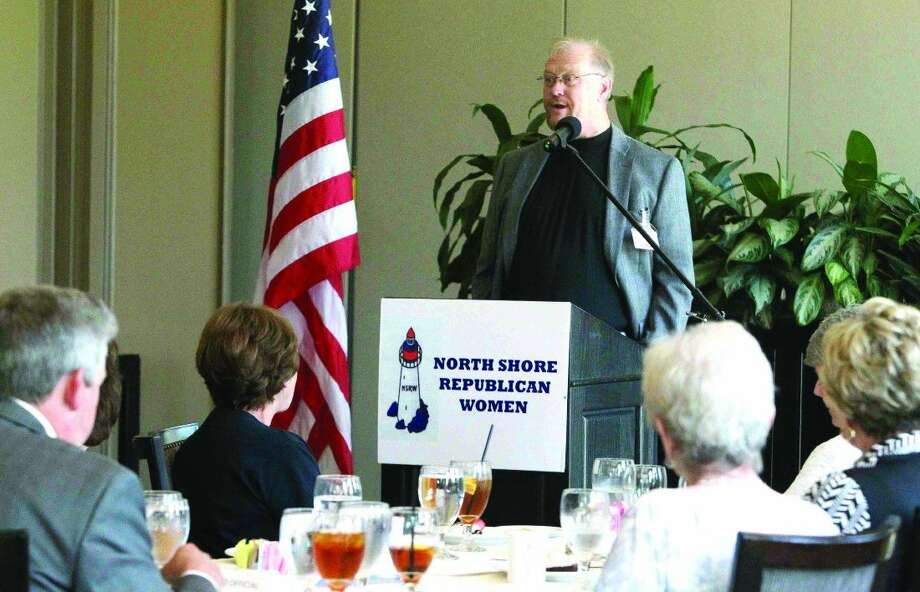 Dave Perkins speaks during a North Shore Republican Women's meeting Wednesday. Photo: Jason Fochtman
