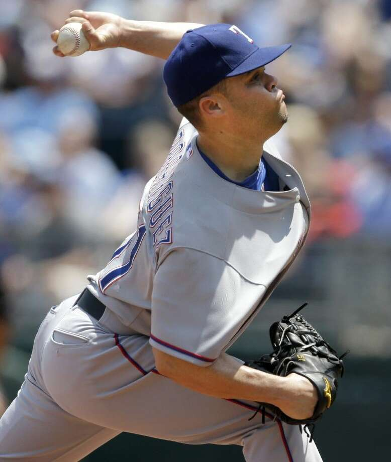 Texas Rangers starting pitcher Wandy Rodriguez delivers to a Kansas City Royals batter during the first inning at Kauffman Stadium in Kansas City, Mo., Saturday, Photo: Orlin Wagner