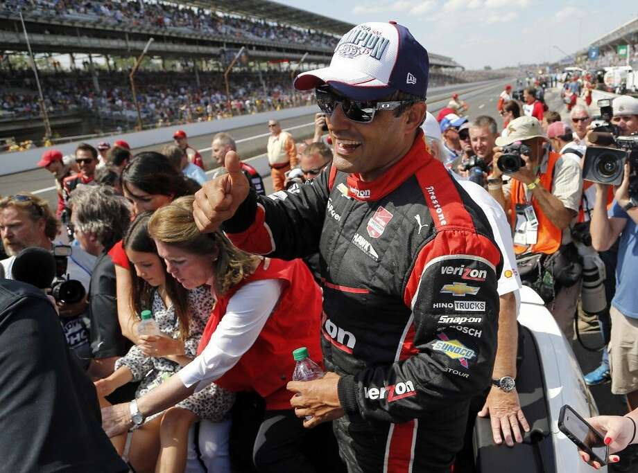 Juan Pablo Montoya, of Colombia, celebrates after winning the 99th running of the Indianapolis 500. Photo: Sam Riche