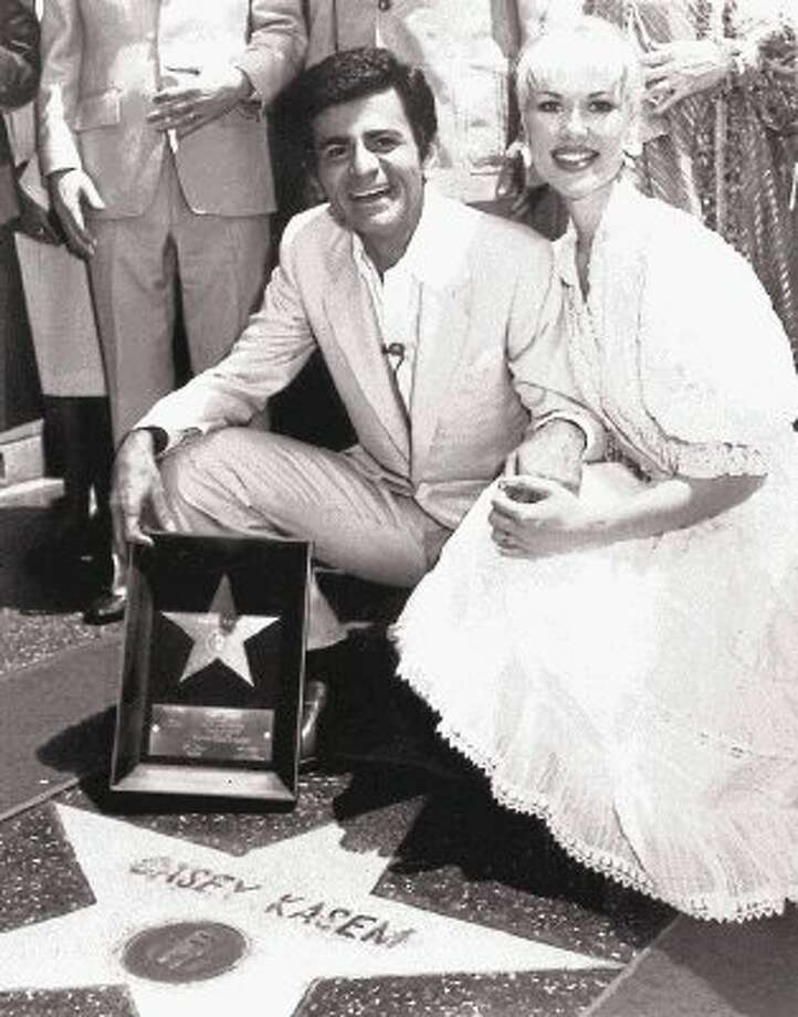 "In this April 27, 1981 file photo, Casey Kasem and his wife Jean smile as he receives his own ""Star"" on the Hollywood Walk of Fame in Los Angeles. Kasem, the smooth-voiced radio broadcaster who became the king of the top 40 countdown, died Sunday, June 15, 2014, according to Danny Deraney, publicist for Kasem's daughter, Kerri. He was 82. / @WireImgId=2680339"