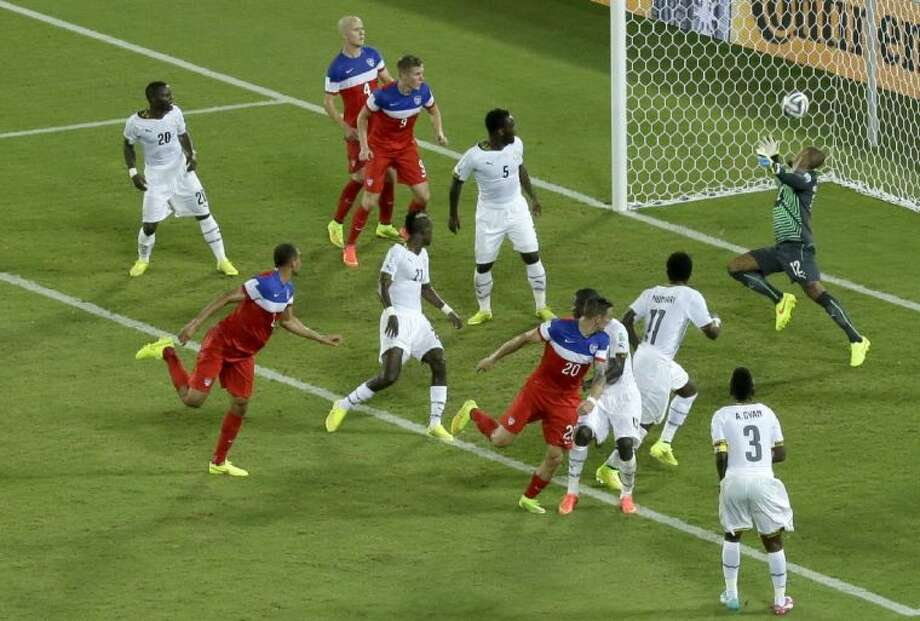 The United States' John Brooks, second from left, delivers the go-ahead goal on a header in the Americans' 2-1 victory over Ghana in the World Cup. Photo: Hassan Ammar