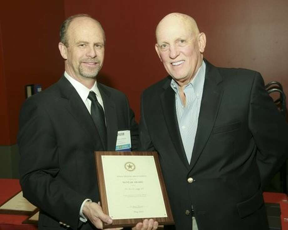 Dr. Jess Legg, right, receives an award for 50 years of dentistry service. Photo: Picasa