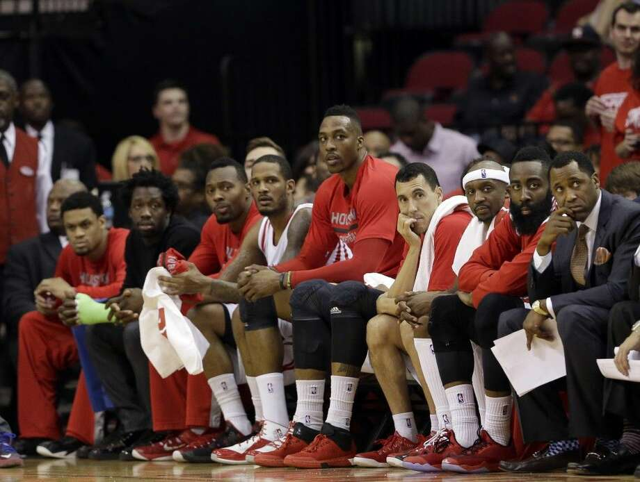 Rockets players watch the final moments in Game 3 in their 110-85 loss to the Warriors. Photo: David J. Phillip