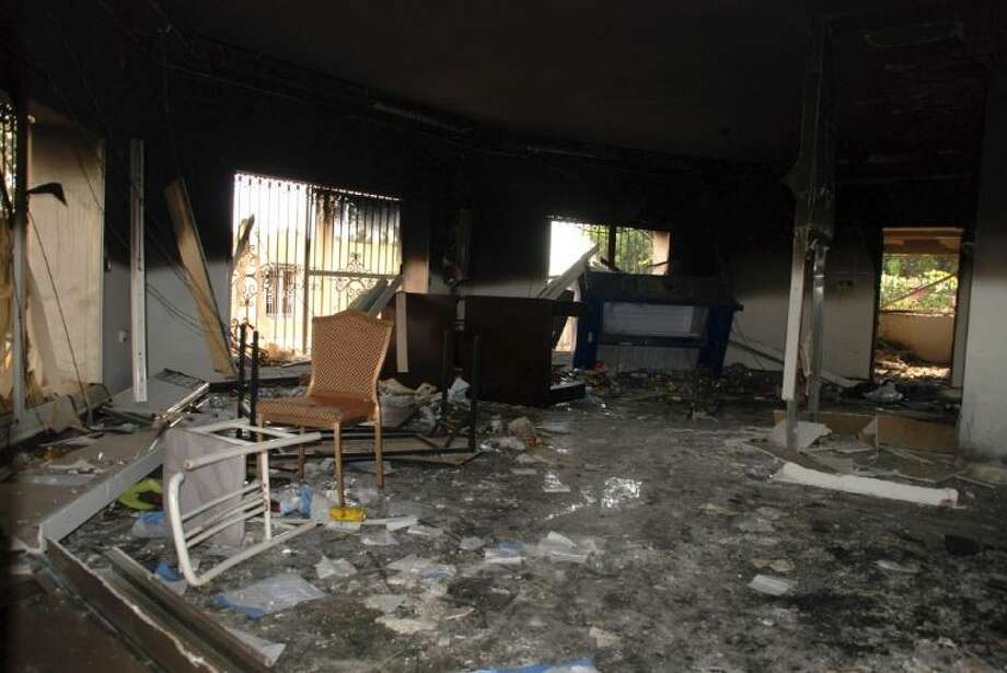 This Sept. 12, 2012 file photo shows glass, debris and overturned furniture are strewn inside a room in the gutted U.S. consulate in Benghazi, Libya, after an attack that killed four Americans, including Ambassador Chris Stevens. The Pentagon says a Libyan militant accused in a deadly attack on Americans in Benghazi, Libya, is in U.S. custody. The capture of Ahmed Abu Khattala marks the first time the U.S has apprehended one of the accused perpetrators in the 2012 attack. Khattala is a senior leader of the Benghazi branch of the terrorist group Ansar al-Sharia.