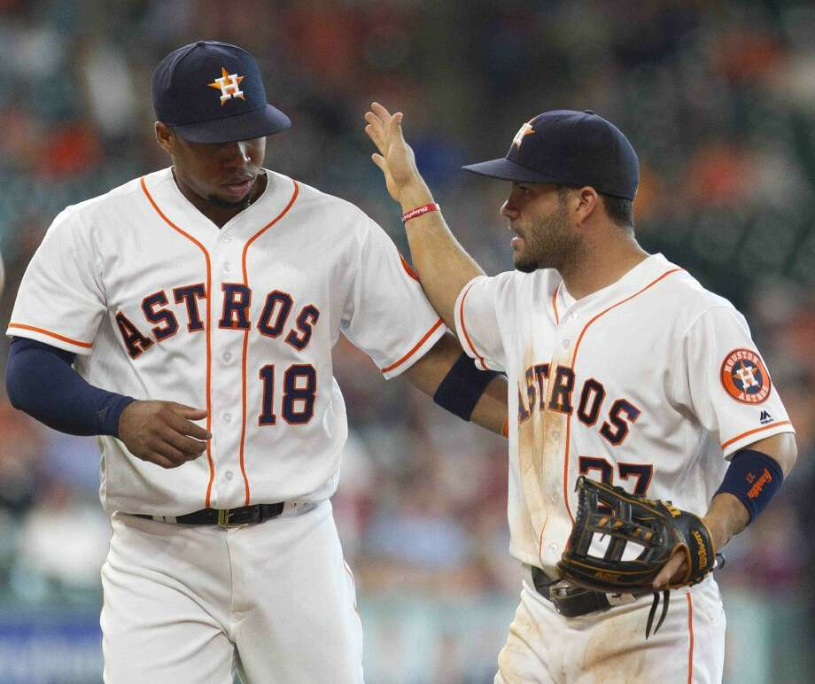 Houston second baseman Jose Altuve celebrates with third baseman Luis Valbuena after turning a double play during the sixth inning of an MLB game Wednesday, May 11, 2016, in Houston. Photo: Jason Fochtman