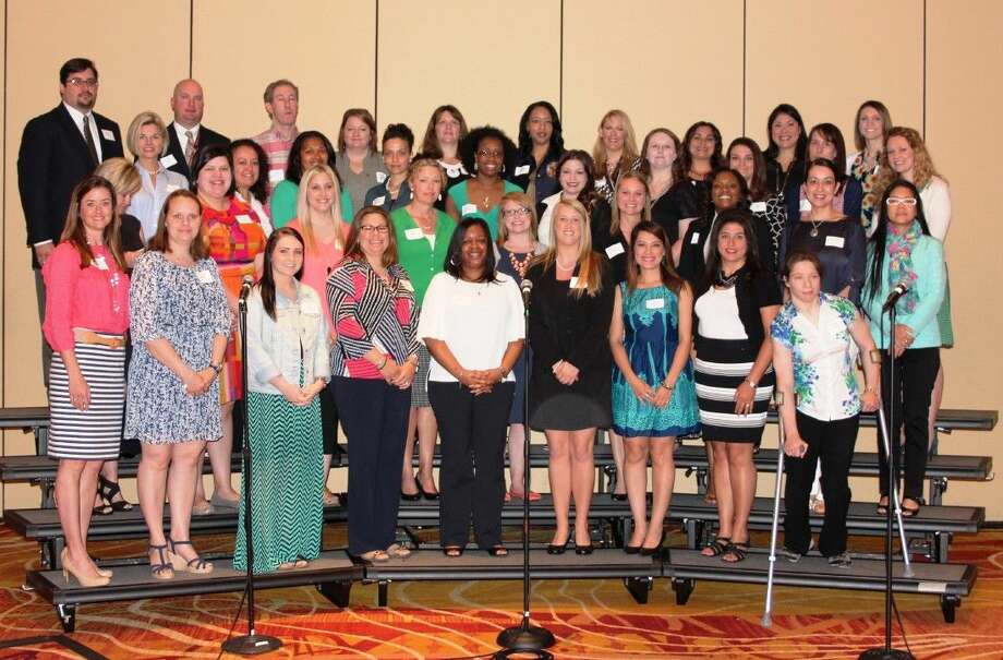 Conroe ISD employee scholarship winners pose after receiving Conroe ISD Education Foundation continuing education awards.
