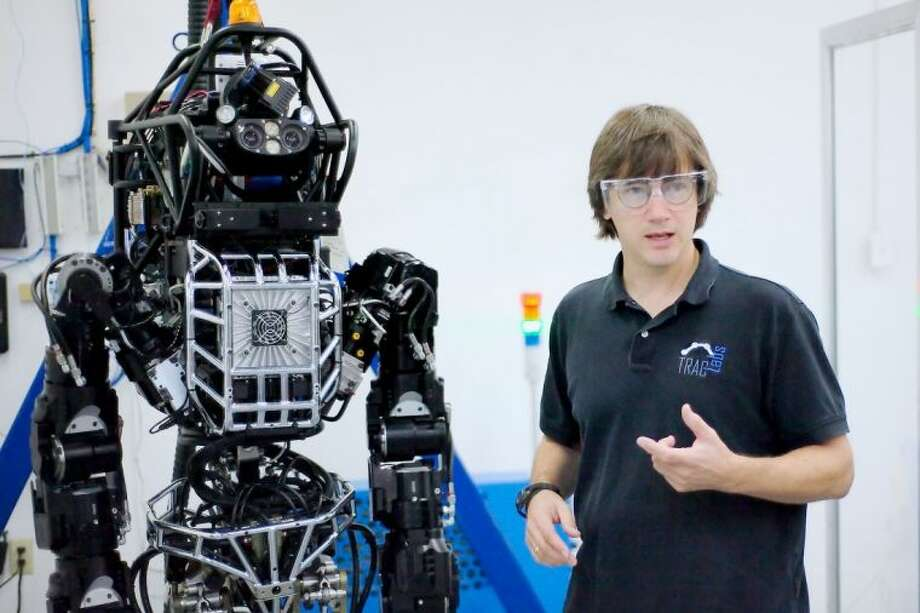 "TRACLabs' Dr. Robert Burridge, Ph.D. describes ""Hercules"" a humanoid robot designed for hazardous rescue operations Tuesday, Sept. 24. Photo: KIRK SIDES"