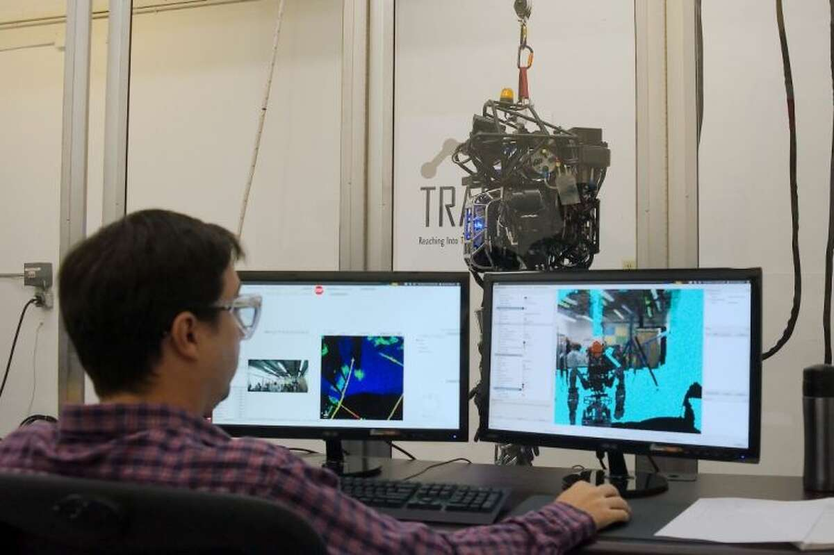 TRACLabs Sr. Scientist Patrick Beeson manipulates the humanoid robot