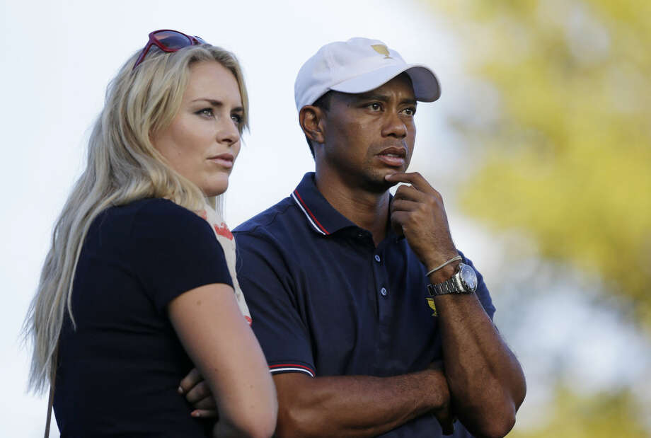 FILE - This Oct. 3, 2013 file photo shows Tiger Woods watching with his girlfriend Lindsey Vonn at the Presidents Cup golf tournament at Muirfield Village Golf Club in Dublin, Ohio. Vonn announced on Sunday, May 3, 2015, that she and Woods have decided to end their three-year relationship. (AP Photo/Darron Cummings, file) Photo: Darron Cummings