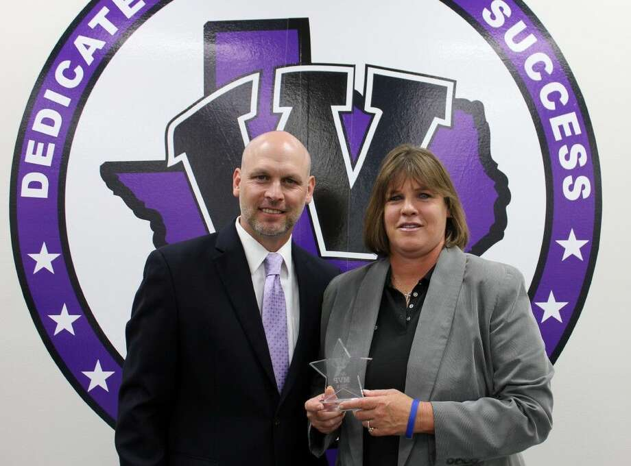 Willis ISD Superintendent Tim Harkrider congratulates Willis High School Head Softball Coach Stephanie Shelly for being named the district's June most valuable player.