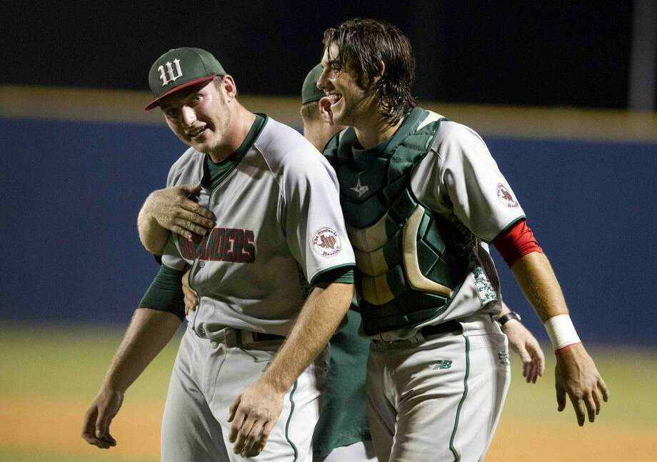 The Woodlands catcher Zach Gartner celebrates with pitcher Chris Andritsos after upsetting Klein 2-1 during a bi-district playoff game last Thursday. Both Gartner and Andritsos hit solo home runs in the team's 2-1 win. To view or purchase this photo and others like it, visit HCNpics.com.