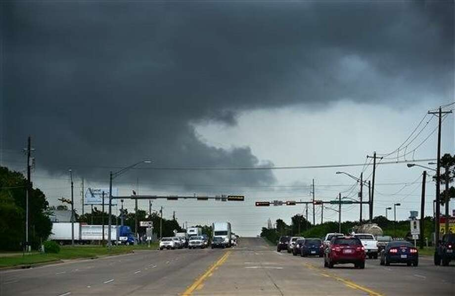 Ominous low-hanging clouds accompanied a thunderstorm from the outer bands of Tropical Storm Bill that was already reaching north Texas as this cell passed over East University Drive in Denton Tuesday. Photo: Al Key