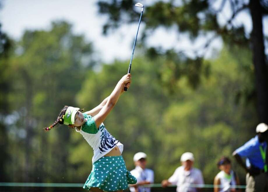 Amateur Lucy Li, 11, hits from the fairway on the 15th hole during a practice round at the U.S. Women's Open on Tuesday at Pinehurst No. 2 in Pinehurst, N.C. The sixth-grader from California is the youngest qualifier in the history of the U.S. Women's Open.