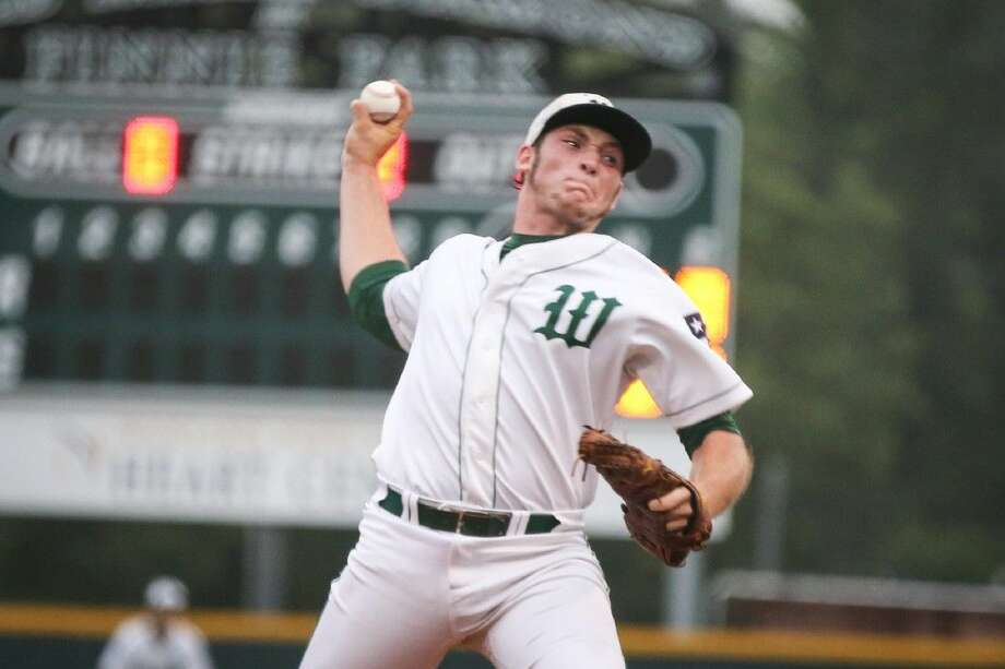 The Woodlands' Chris Andritsos throws a pitch against Austin Bowie. To view more photos from the game, go to HCNPics.com. Photo: Michael Minasi