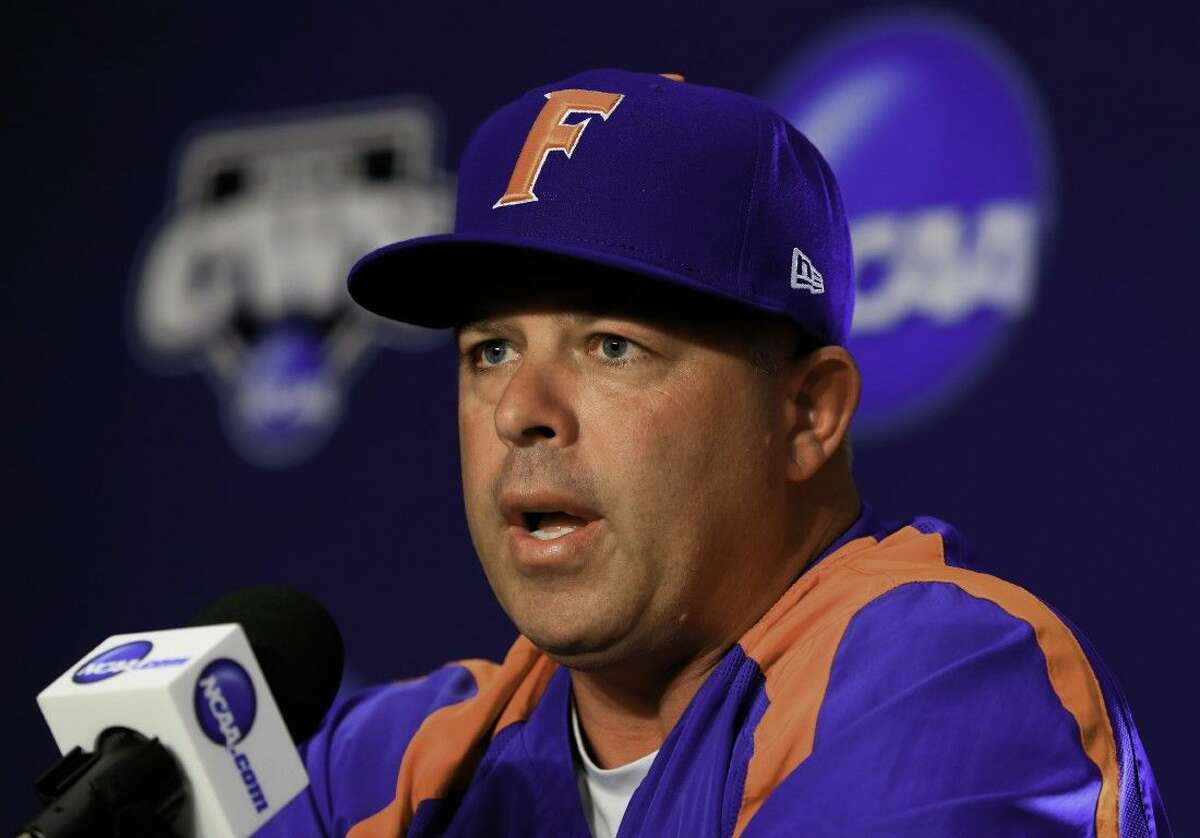 Florida coach Kevin O'Sullivan speaks during a coaches news conference, Friday in Omaha, Neb. Florida plays Miami on Saturday in an NCAA College World Series baseball game at TD Ameritrade Park in Omaha.