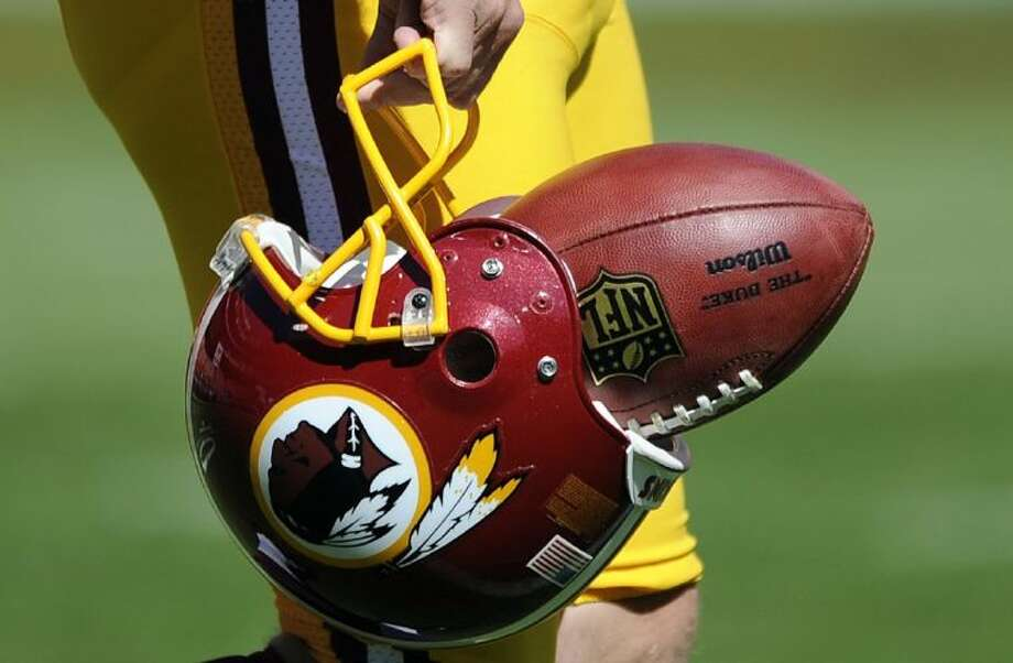 """The U.S. Patent Office ruled Wednesday that the Washington Redskins nickname is """"disparaging of Native Americans"""" and that the team's federal trademarks for the name must be canceled. The ruling comes after a campaign to change the name has gained momentum over the past year. Photo: Nick Wass"""
