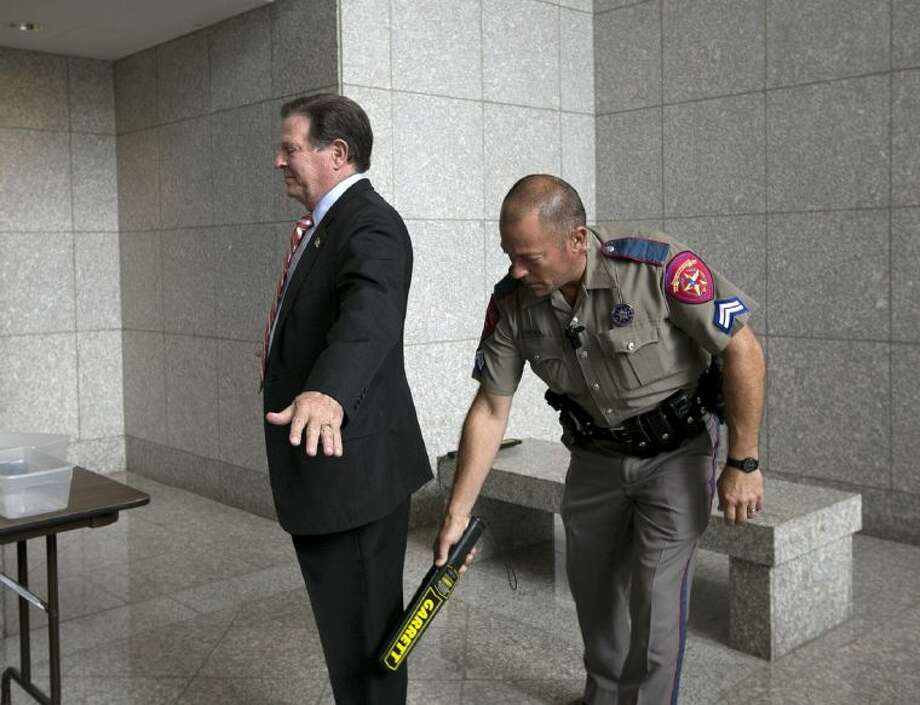 Tom Delay goes through security after arriving at the Texas Court of Criminal Appeals in Austin on Wednesday.