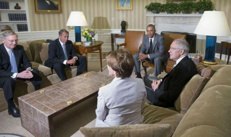 President Barack Obama meets with, from left, Senate Minority Leader Mitch McConnell of Ky., House Speaker John Boehner of Ohio, House Minority Leader Nancy Pelosi of Calif., and Senate Majority Leader Harry Reid of Nev., in the Oval Office of the White House Wednesday.
