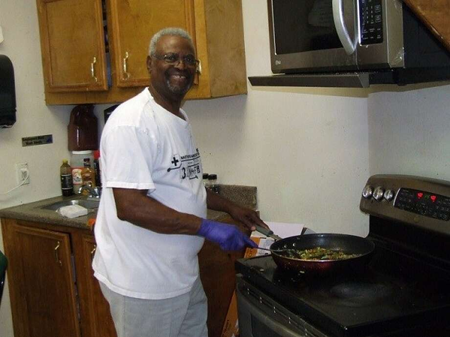 May was Women's Month at West Tabernacle Church in Conroe. At the end of the month, the men honored the women with a breakfast. They had a special menu from which they could make their selection. The men served as waiters, while others served as chefs. Pictured is Deacon Sam White, scrambling some Spanish- style eggs.