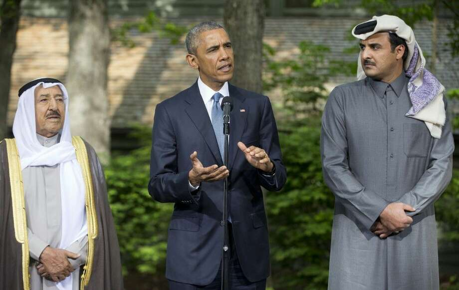 President Barack Obama, center, with Kuwaiti Emir Sheikh Sabah Al-Ahmad Al-Sabah, left, and Qatar's Emir Sheikh Tamim bin Hamad Al-Thani, right, as he makes a statement to members of the media after meeting with Gulf Cooperation Council leaders and delegations at Camp David in Maryland, Thursday. Photo: Pablo Martinez Monsivais