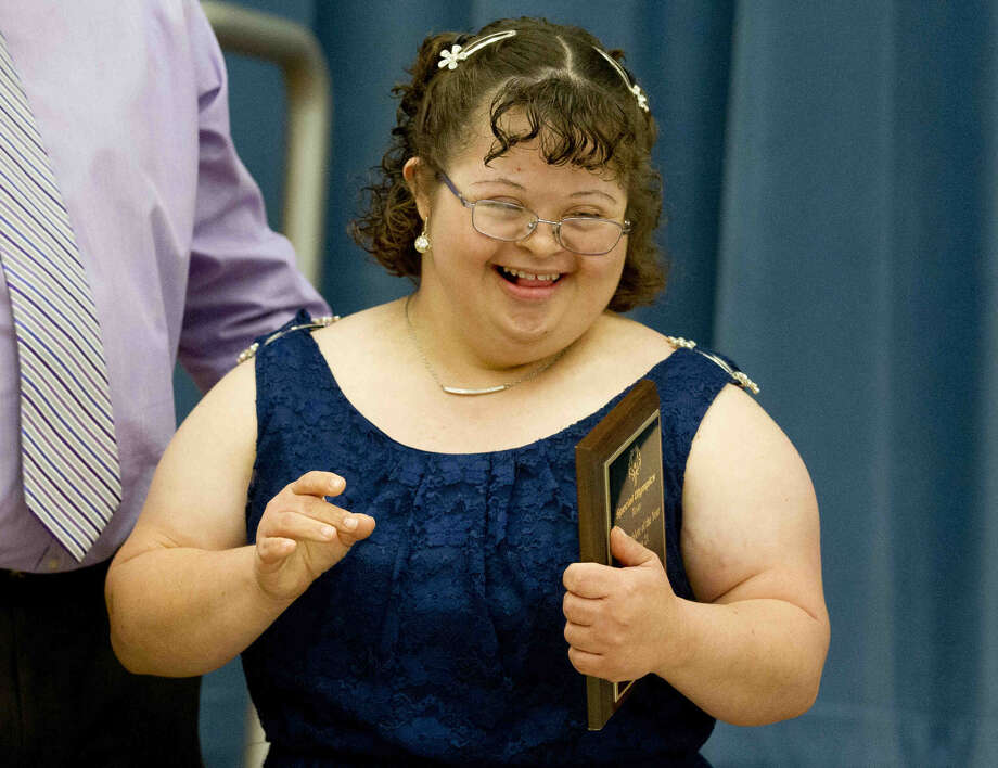 Conroe High School's Aerianna DeLuna smiles after being named the Area 6 Female Athlete of the Year during the Conroe Stars Special Olympics banquet Tuesday at Wilkinson Elementary. Go to HCNpics.com to purchase this photo and others like it. Photo: Jason Fochtman