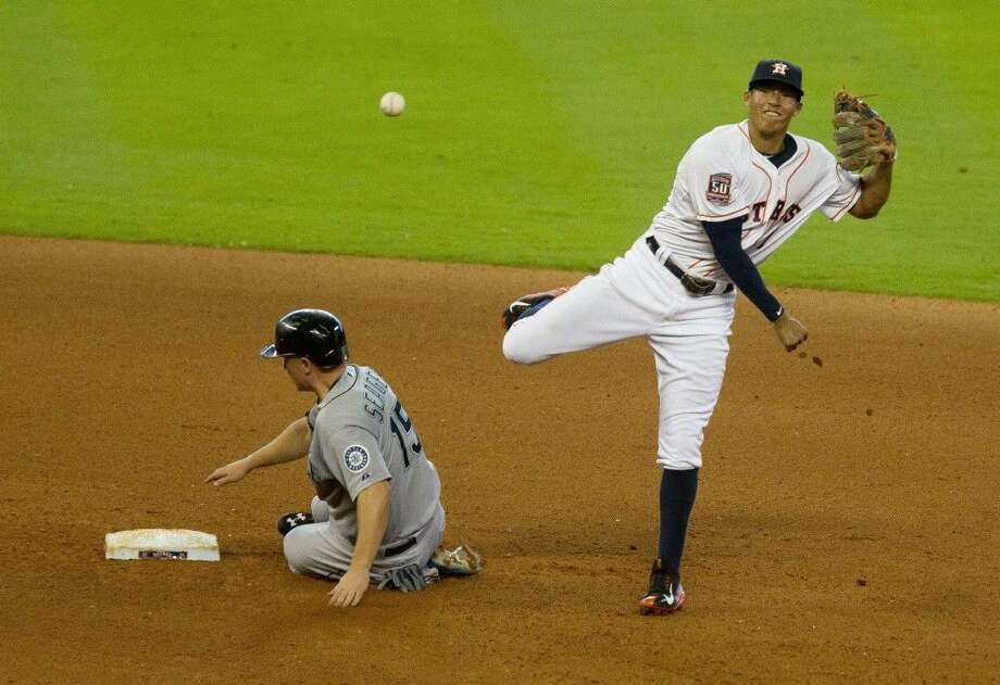 Astros shorstop Carlos Correa turns a fourth-inning double play against the Seattle Mariners. The Mariners rolled to an 8-1 victory over the Astros. Photo: Jason Fochtman